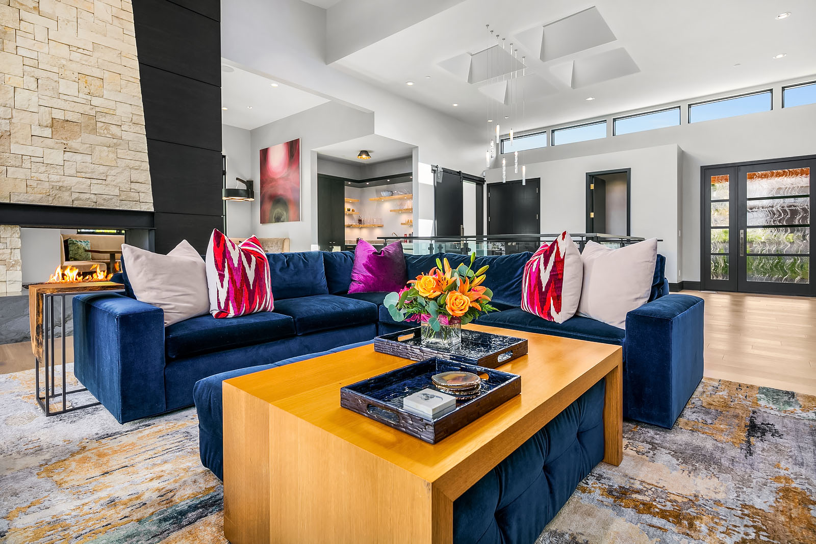 Bellevue, Washington close up of living room with blue couch and colorful pillows with wooden accent table